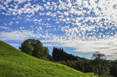 Green hill and blue sky (Germany) — Stock Photo