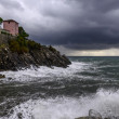 House on cliffs at rainstorm (Nervi, Italy) — Stock Photo
