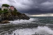 House on cliffs at rainstorm (Nervi, Italy) — Stock Photo