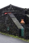 Orange amphora on black wall, Pico island, Azores archipelago (P — Stock Photo