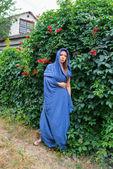 Girl in a blue cloak — Stock Photo