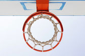 Basketball backboard below the net — Stock Photo