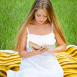 Young beautiful girl with book in nature — Stock Photo