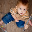 Baby with colorful pencils — Stock Photo