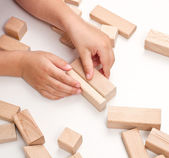 Hand make a building of wooden toy blocks — Stock Photo