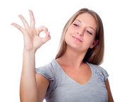 Girl shows gesture of approval to something — Stock Photo