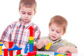 Boy playing with wooden blocks — Stock Photo