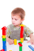Boy playing wooden blocks — Stock Photo