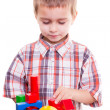 Boy playing wooden blocks — Stockfoto