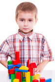 Boy playing wooden blocks — Stock Photo