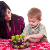 Mother with son make advent wreath — Стоковое фото