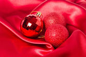 Christmas balls on silk — Stock Photo