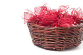 Red christmas bows in wicker basket — Foto Stock