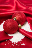 Christmas bauble decorating with sugar as snow — Stock Photo