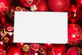 Christmas ornaments - red balls and text area on blank xmas card — Stock Photo