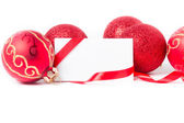 Greeting card with red Christmas baubles on a background — Stock Photo