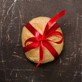 Bread with red ribbon — Stock Photo
