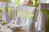 Table set for wedding dinner decorated with flowers — Stock Photo