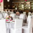 An image of tables setting at a luxury wedding hall — Stock Photo #48483313
