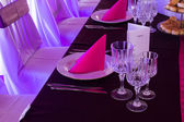 Pink and purple light wedding table — Stock Photo