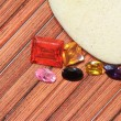 Gemstone on wood background — Stock Photo
