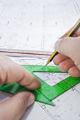 Architect drawing a building plan — Stock Photo