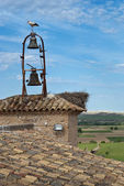 Storks on the bell tower of the church — Stock Photo
