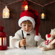 Little boy on christmas, writing letter to Santa — Stock fotografie #32070371