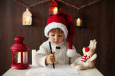 Little boy on christmas, writing letter to Santa — Stock Photo