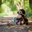 Autumn portrait of a boy with airplane in a park — Foto Stock