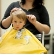 Boy, having haircut at the barber shop — Stock Photo