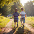 Two brothers in the park, walking together — Stock Photo