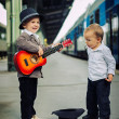 Boy with a guitar on a railway station — Stock Photo