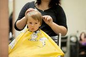 Boy, having haircut at the barber shop — Stock Photo