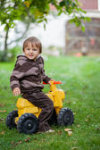 Boy on a motor cycle — Stock Photo