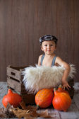 Boy with hat and suspenders in a wooden tray — Foto Stock