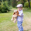 Boy with fluffy dog toy — Stock Photo #32465609