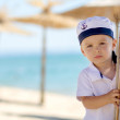 Little sailor boy on the beach — Stock Photo