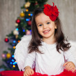 Christmas portrait of a little girl — Stock Photo