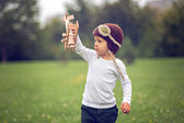 Boy with airplane and aviator hat — Stock Photo