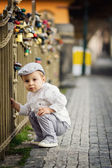 Boy next to a fence with lockers — Stock Photo