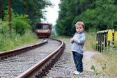 Boy, standing next to a railway — Stock Photo