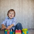 Boy, playing with wooden train — Stock Photo #32573545