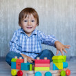Boy, playing with wooden train — Stock Photo #32573683