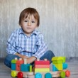Boy, playing with wooden train — Stock Photo #32573731