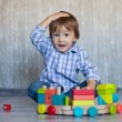 Boy, playing with wooden train — Stock Photo #32573743