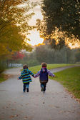 Brothers running in a park — Stock Photo