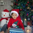 Boy, opening present on christmas — Stock Photo #36813079