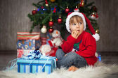 Little boy opening presents for chrismas — Stock Photo