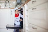 Little boy, baking muffins — Stock Photo